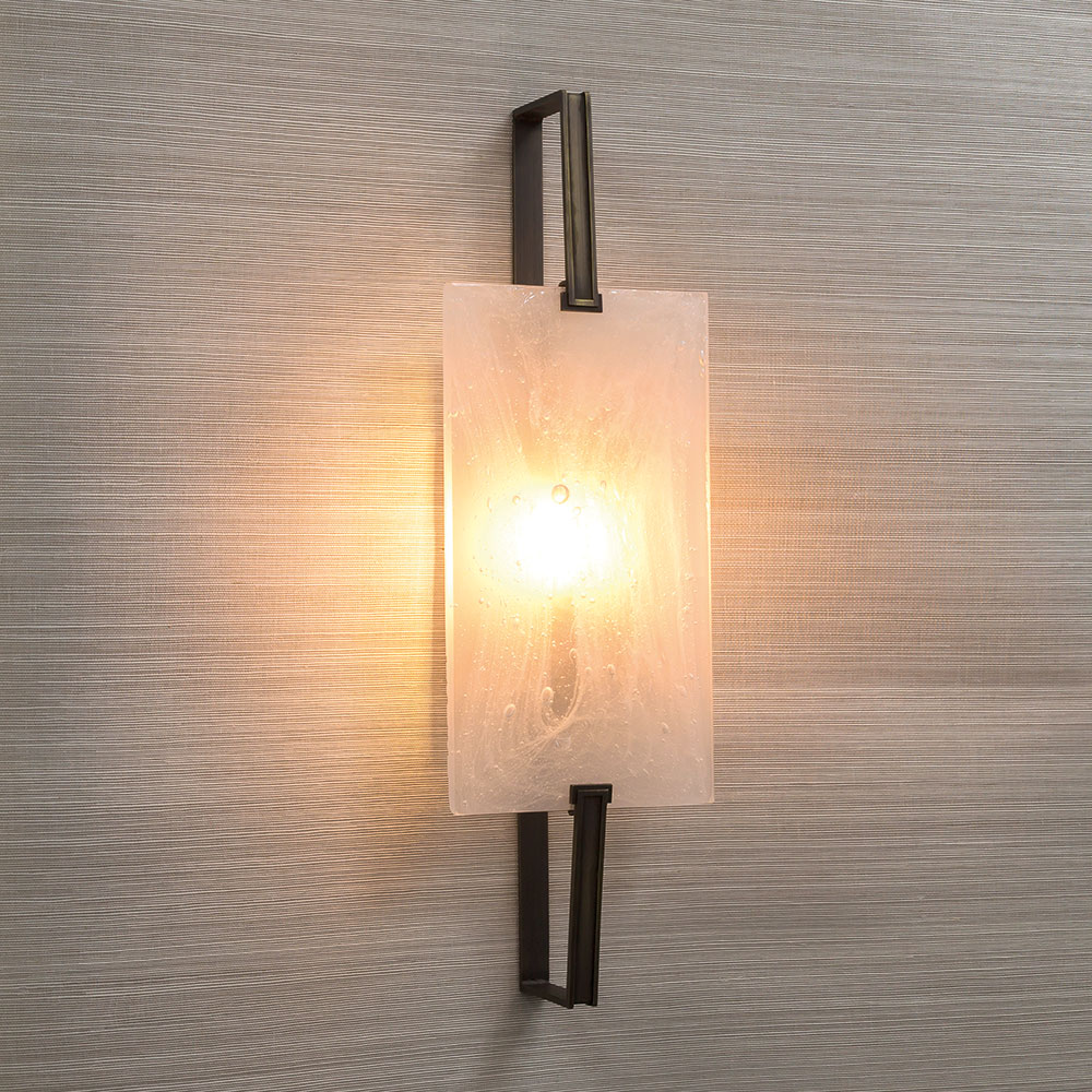 The 'Facet' Wall Light, sandblasted 'Dry Ice' glass crafted in Italy with Brushed Dark Bronze metal work.